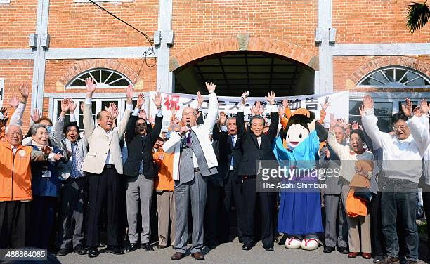 Tomioka Mayor Kentaro Iwai local volunteers and residents celebrate a UNESCO advisory council's recommendation of the Tomioka Silk Mill for...