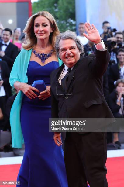 Tommasa Giovannoni and Renato Brunetta walk the red carpet ahead of the 'Downsizing' screening and Opening Ceremony during the 74th Venice Film...