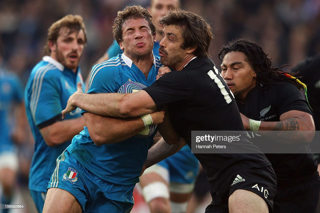 Tommaso Benvenuti of Italy is tackled by <a gi-track='captionPersonalityLinkClicked' href=/galleries/search?phrase=Conrad+Smith&family=editorial&specificpeople=644500 ng-click='$event.stopPropagation()'>Conrad Smith</a> of the All Blacks during the international rugby match between Italy and New Zealand at Stadio Olimpico on November 17, 2012 in Rome, Italy.