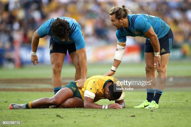 Tommaso Boni and Michele Campagnaro of Italy show concern over the injured Sefa Naivalu of the Wallabies during the International Test match between...
