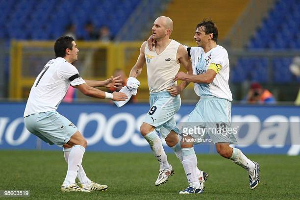 Tommaso Rocchi is congratulated by Sebastiano Siviglia and Alexander Kolarov of SS Lazio after scoring the third goal during the Serie A match...
