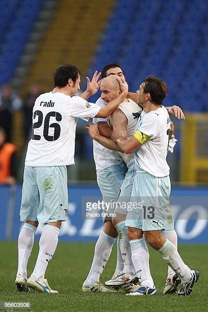 Tommaso Rocchi is congratulated by Sebastiano Siviglia and Stefan Radu Alexander Kolarov of SS Lazio celebrate the third goal during the Serie A...