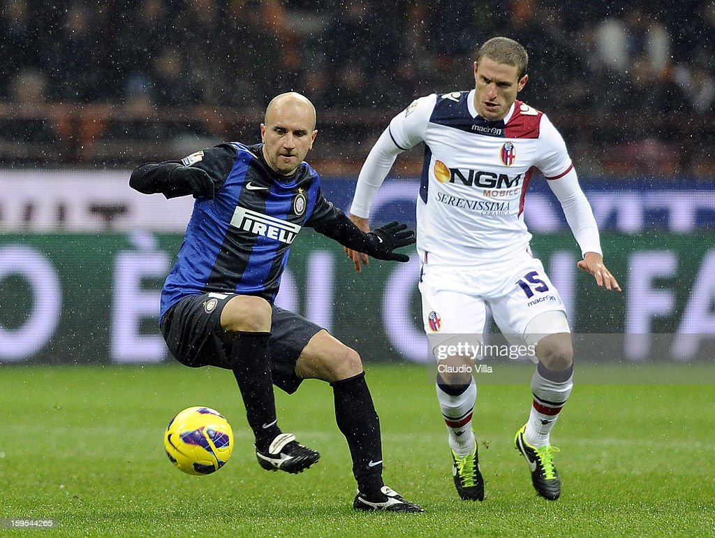 <a gi-track='captionPersonalityLinkClicked' href=/galleries/search?phrase=Tommaso+Rocchi&family=editorial&specificpeople=676388 ng-click='$event.stopPropagation()'>Tommaso Rocchi</a> of FC Inter Milan (L) and <a gi-track='captionPersonalityLinkClicked' href=/galleries/search?phrase=Diego+Perez&family=editorial&specificpeople=697338 ng-click='$event.stopPropagation()'>Diego Perez</a> of Bologna FC compete for the ball during the TIM cup match between FC Internazionale Milano and Bologna FC at Stadio Giuseppe Meazza on January 15, 2013 in Milan, Italy.