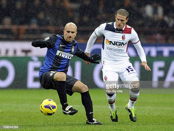Tommaso Rocchi of FC Inter Milan and Diego Perez of Bologna FC compete for the ball during the TIM cup match between FC Internazionale Milano and...