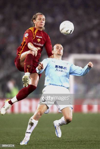 Tommaso Rocchi of Lazio challenges Philippe Mexes of Roma during the Serie A match between Lazio and Roma at the Stadio Olimpico on February 26 2006...