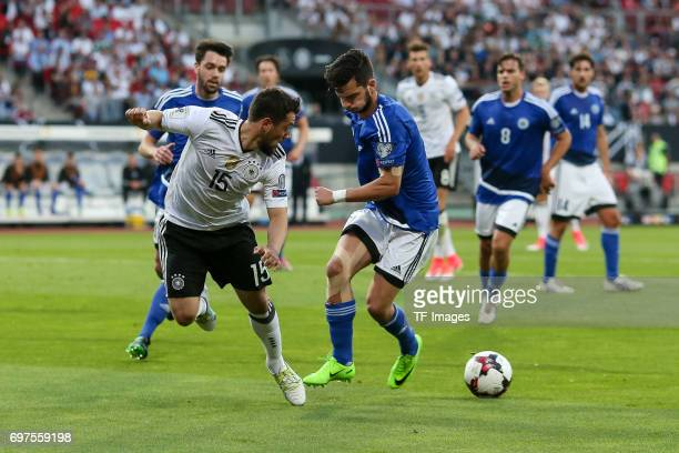 Tommaso Zafferani of San Marino and Amin Younes of Germany battle for the ball during the FIFA 2018 World Cup Qualifier between Germany and San...