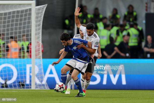 Tommaso Zafferani of San Marino and Emre Can of Germany battle for the ball during the FIFA 2018 World Cup Qualifier between Germany and San Marino...