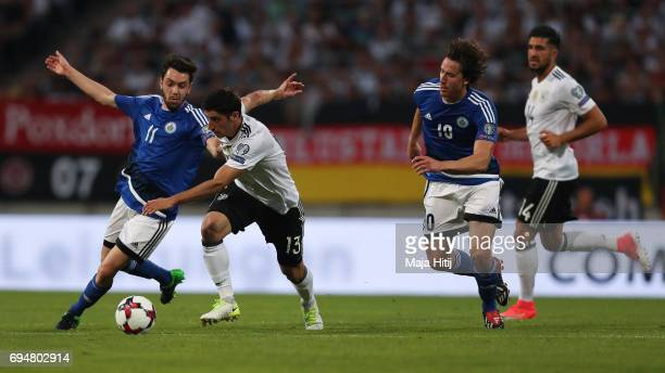 Tommaso Zafferani of San Marino and Lars Stindl of Germany battle for the ball during the FIFA 2018 World Cup Qualifier between Germany and San...