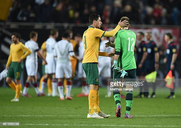 Tommi Juric of Australia shakes hand with goalkeeper RonRobert Zieler of Germany after the International Friendly match between Germany and Australia...