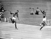 Tommie Smith of the USA wins the men's 200 metres final at the Olympic Games in Mexico City 16th October 1968 Bronze medallist John Carlos also of...