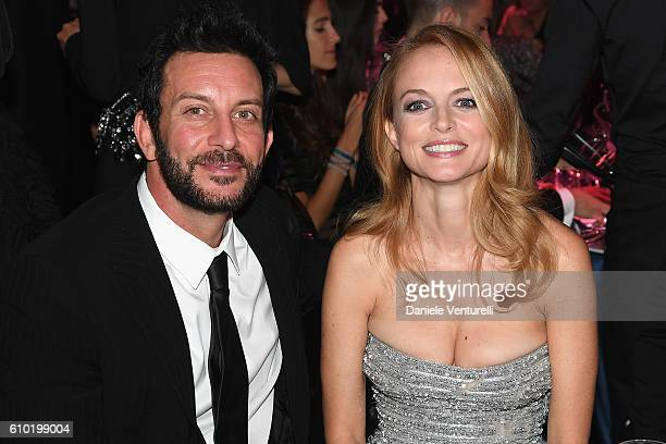 Tommy Alastra and Heather Graham attends the dinner of amfAR Milano 2016 at La Permanente on September 24 2016 in Milan Italy