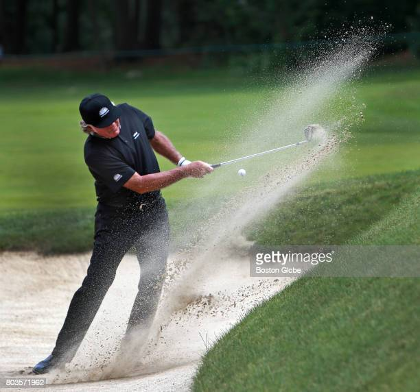 Tommy Armour III blasts out of a green side sand trap on the 2nd hole during the first round of the US Senior Open at the Salem Country Club in...