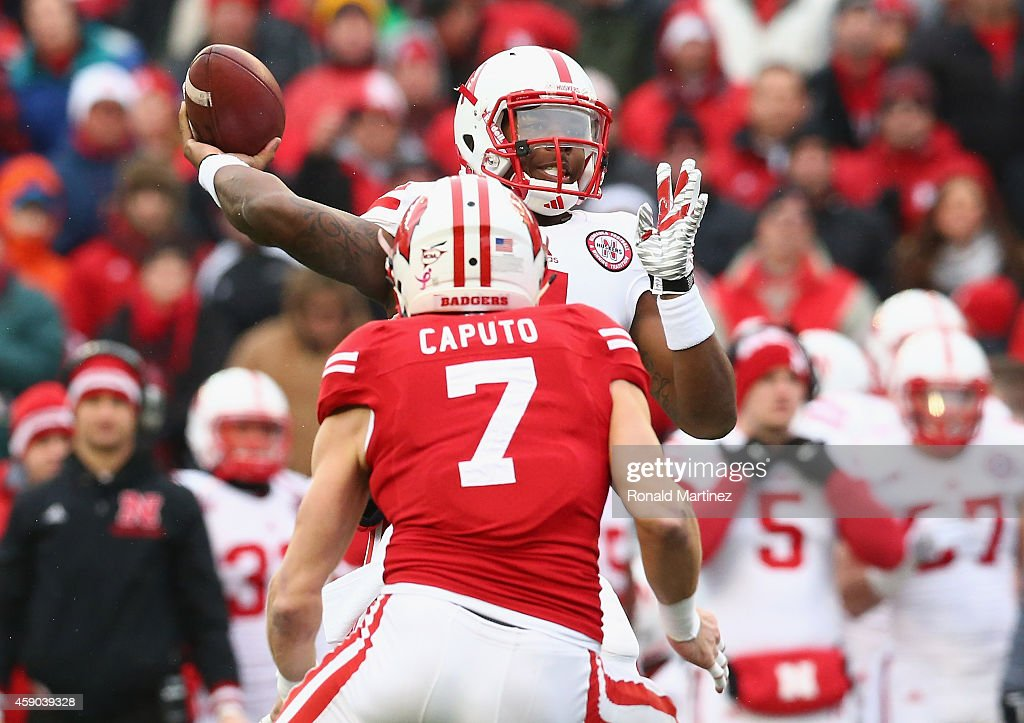 Tommy Armstrong Jr. #4 of the Nebraska Cornhuskers throws the ball against Michael Caputo #7 of the Wisconsin Badgers at Camp Randall Stadium on November 15, 2014 in Madison, Wisconsin.