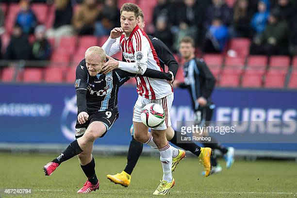 Tommy Bechmann of Sonderjyske and Kasper Risgard of AaB Aalborg compete for the ball during the Danish Alka Superliga match between AaB Aalborg and...