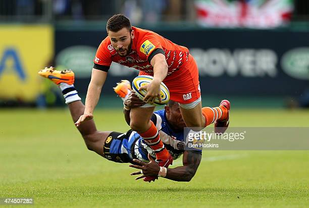 Tommy Bell of Leicester is tackled by Semesa Rokoduguni of Bath during the Aviva Premiership Semi Final match between Bath Rugby and Leicester Tigers...