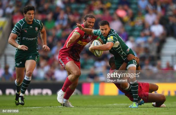 Tommy Bell of London Irish is tackled by Joe Marchant and Jamie Roberts of Harlequins during the Aviva Premiership match between London Irish and...