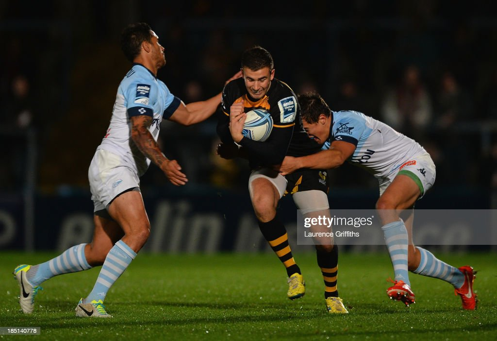 Tommy Bell of London Wasps is tackled by Mathieu Ugalde of Bayonne during the Amlin Challenge Cup round two match between London Wasps and Bayonne at Adams Park on October 17, 2013 in High Wycombe, England.
