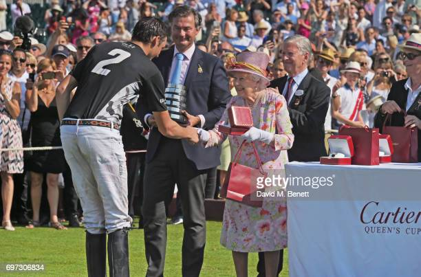 Tommy Beresford Laurent Feniou Queen Elizabeth II and Jock GreenArmytage attend the Cartier Queen's Cup Polo final at Guards Polo Club on June 18...