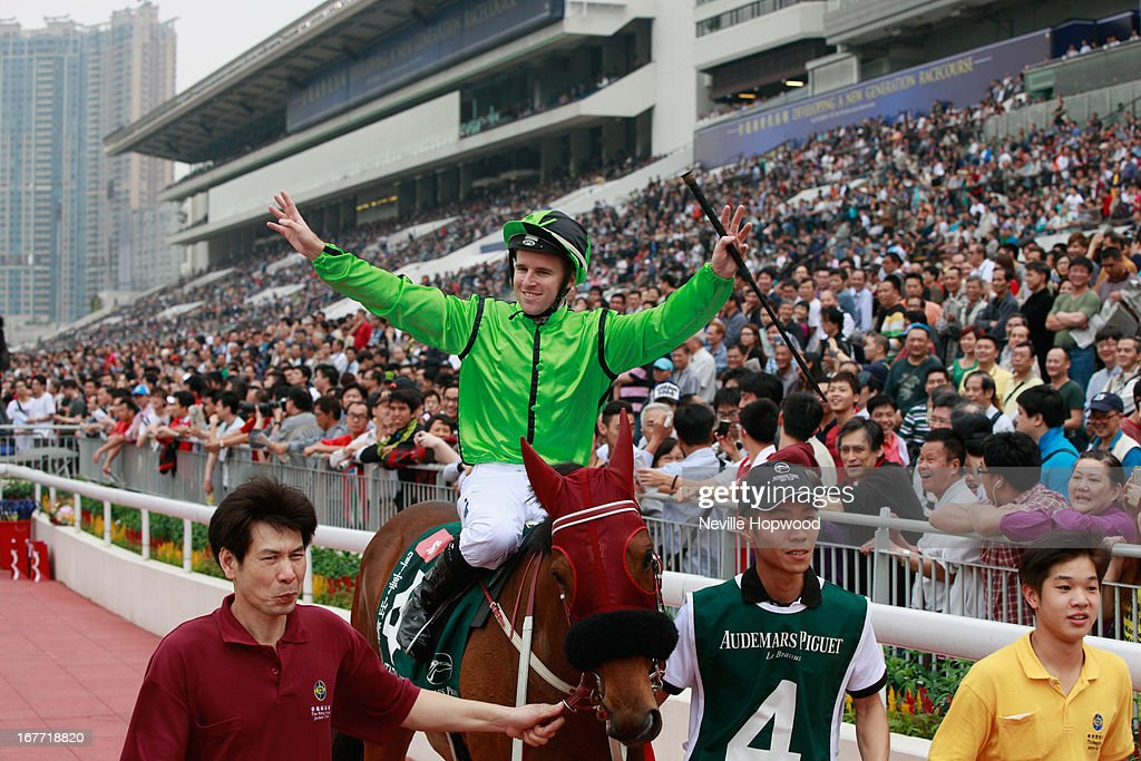 Tommy Berry celebrates winning the Queen Elizabeth II Cup on Military Attack during the Audemars Piguet Queen Elizabeth II race meeting at Sha Tin racecourse on April 28, 2013 in Hong Kong, Hong Kong.