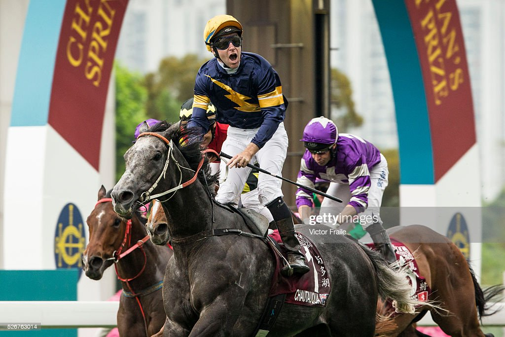 Tommy Berry riding Chautauqua (C) celebrates after winning The Chairman's Sprint Prize race at Sha Tin Racecourse on May 1, 2016 in, Hong Ko