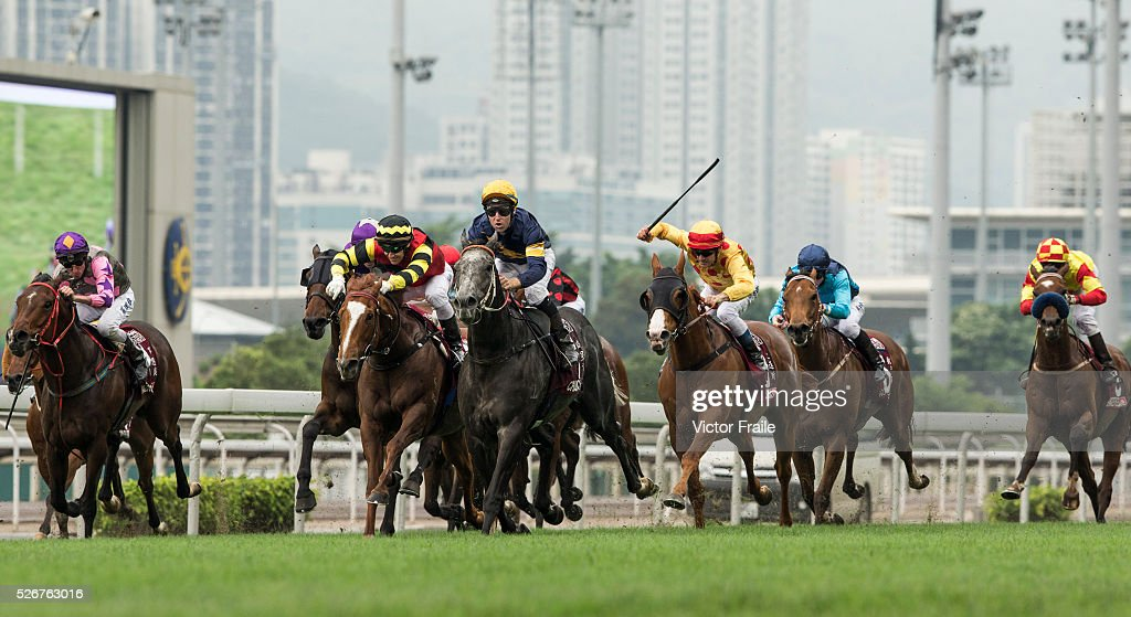 Tommy Berry riding Chautauqua (C) on their way to win The Chairman's Sprint Prize race at Sha Tin Racecourse on May 1, 2016 in, Hong Ko