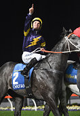 Tommy Berry riding Chautauqua reacts after winning Race 7 William Hill Manikato Stakes during Manikato Stakes Night at Moonee Valley Racecourse on...