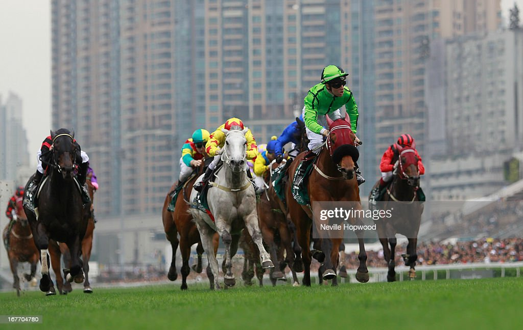 Tommy Berry riding Military Attack wins the Audemars Piguet Queen Elizabeth II during Audemars Piguet Queen Elizabeth II race meeting at Sha Tin racecourse on April 28, 2013 in Hong Kong, Hong Kong.