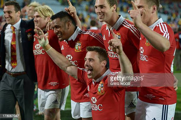 Tommy Bowe and his British and Irish Lions teammates celebrate their win over Australia during the third and final rugby union Test in Sydney on July...