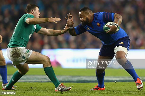 Tommy Bowe of Ireland challenges Mathieu Bastareaud of France during the RBS Six Nations match between Ireland and France at the Aviva Stadium on...