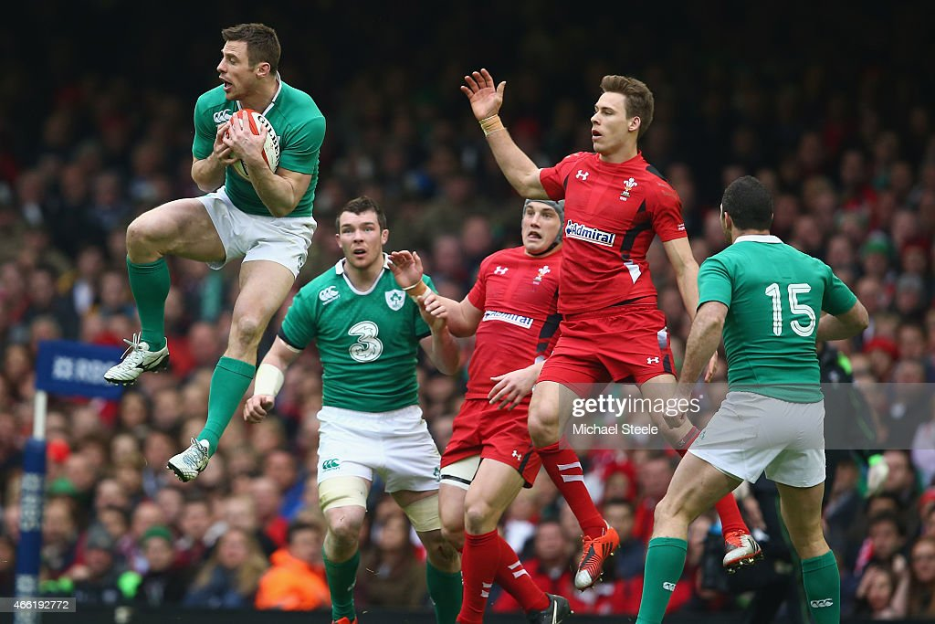 <a gi-track='captionPersonalityLinkClicked' href=/galleries/search?phrase=Tommy+Bowe&family=editorial&specificpeople=556065 ng-click='$event.stopPropagation()'>Tommy Bowe</a> of Ireland claims a high ball from <a gi-track='captionPersonalityLinkClicked' href=/galleries/search?phrase=Liam+Williams+-+Rugby+Union+Player&family=editorial&specificpeople=7852399 ng-click='$event.stopPropagation()'>Liam Williams</a> of Wales during the RBS Six Nations match between Wales and Ireland at the Millennium Stadium on March 14, 2015 in Cardiff, Wales.