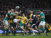 Tommy Bowe of Ireland is tackled by Michael Hooper of Australia during the international friendly match between Ireland and Australia at Aviva...