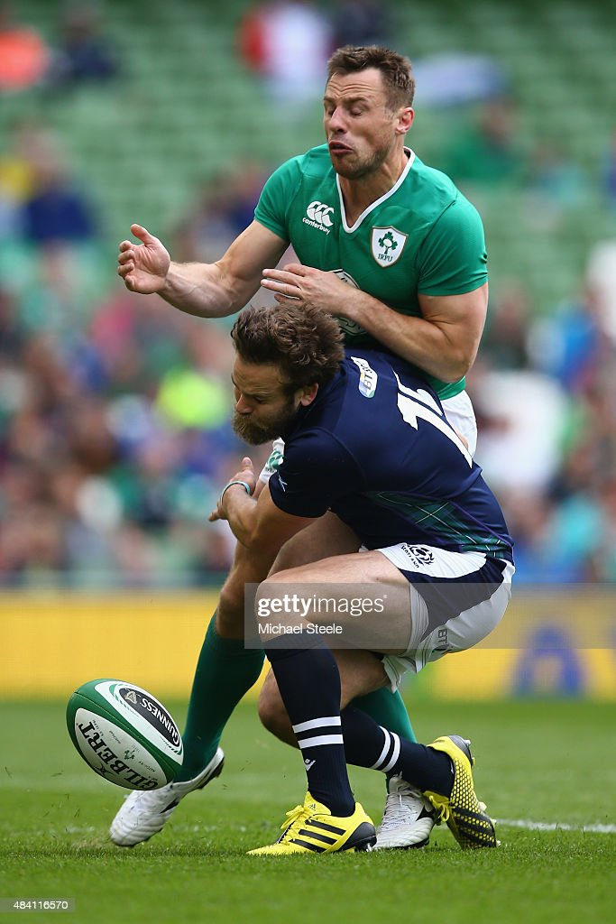 <a gi-track='captionPersonalityLinkClicked' href=/galleries/search?phrase=Tommy+Bowe&family=editorial&specificpeople=556065 ng-click='$event.stopPropagation()'>Tommy Bowe</a> of Ireland is tackled by <a gi-track='captionPersonalityLinkClicked' href=/galleries/search?phrase=Ruaridh+Jackson&family=editorial&specificpeople=4052398 ng-click='$event.stopPropagation()'>Ruaridh Jackson</a> of Scotland during the International match between Ireland and Scotland at the Aviva Stadium on August 15, 2015 in Dublin, Ireland.