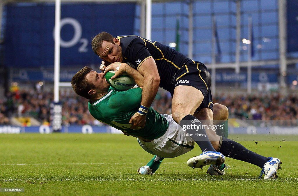 <a gi-track='captionPersonalityLinkClicked' href=/galleries/search?phrase=Tommy+Bowe&family=editorial&specificpeople=556065 ng-click='$event.stopPropagation()'>Tommy Bowe</a> of Ireland is tackled on the try line by <a gi-track='captionPersonalityLinkClicked' href=/galleries/search?phrase=Graeme+Morrison&family=editorial&specificpeople=596234 ng-click='$event.stopPropagation()'>Graeme Morrison</a> of Scotland during the RBS Six Nations match between Ireland and Scotland at Aviva Stadium on March 10, 2012 in Dublin, Ireland.