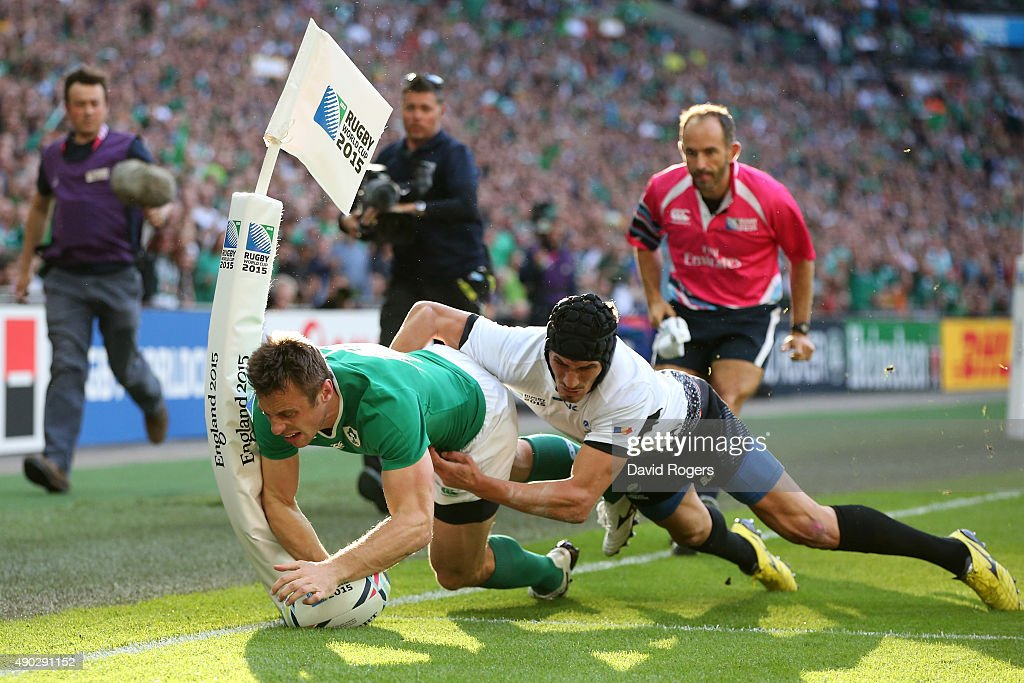 <a gi-track='captionPersonalityLinkClicked' href=/galleries/search?phrase=Tommy+Bowe&family=editorial&specificpeople=556065 ng-click='$event.stopPropagation()'>Tommy Bowe</a> of Ireland scores his teams first try during the 2015 Rugby World Cup Pool D match between Ireland and Romania at Wembley Stadium on September 27, 2015 in London, United Kingdom.