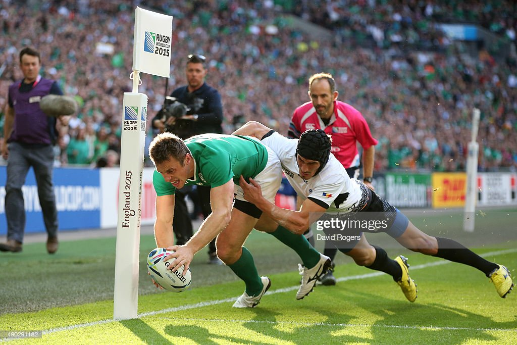 Tommy Bowe of Ireland scores his teams first try during the 2015 Rugby World Cup Pool D match between Ireland and Romania at Wembley Stadium on September 27, 2015 in London, United Kingdom.