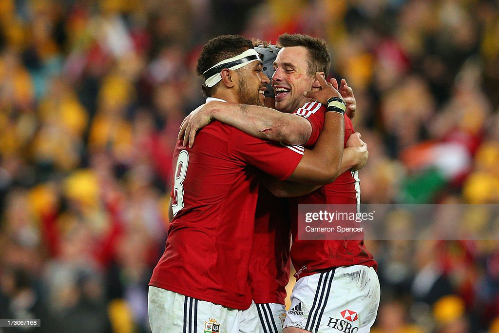 <a gi-track='captionPersonalityLinkClicked' href=/galleries/search?phrase=Tommy+Bowe&family=editorial&specificpeople=556065 ng-click='$event.stopPropagation()'>Tommy Bowe</a> (R) of the Lions, <a gi-track='captionPersonalityLinkClicked' href=/galleries/search?phrase=Toby+Faletau&family=editorial&specificpeople=6522513 ng-click='$event.stopPropagation()'>Toby Faletau</a> and Jonathan Davies of the Lions celebrate at full time as the Lions win the International Test match between the Australian Wallabies and British & Irish Lions at ANZ Stadium on July 6, 2013 in Sydney, Australia.