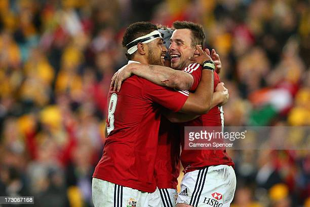 Tommy Bowe of the Lions Toby Faletau and Jonathan Davies of the Lions celebrate at full time as the Lions win the International Test match between...