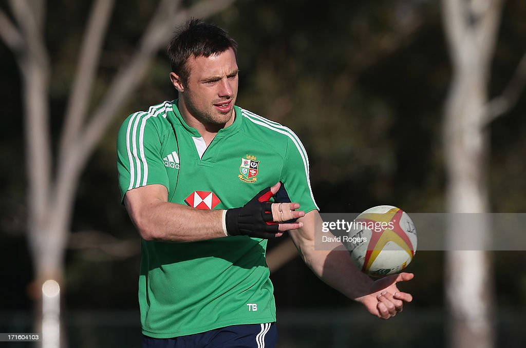 <a gi-track='captionPersonalityLinkClicked' href=/galleries/search?phrase=Tommy+Bowe&family=editorial&specificpeople=556065 ng-click='$event.stopPropagation()'>Tommy Bowe</a>, who has been selected to play for the Lions in the second test match against the Wallabies, passes the ball during the British and Irish Lions training session held at Scotch College on June 27, 2013 in Melbourne, Australia.