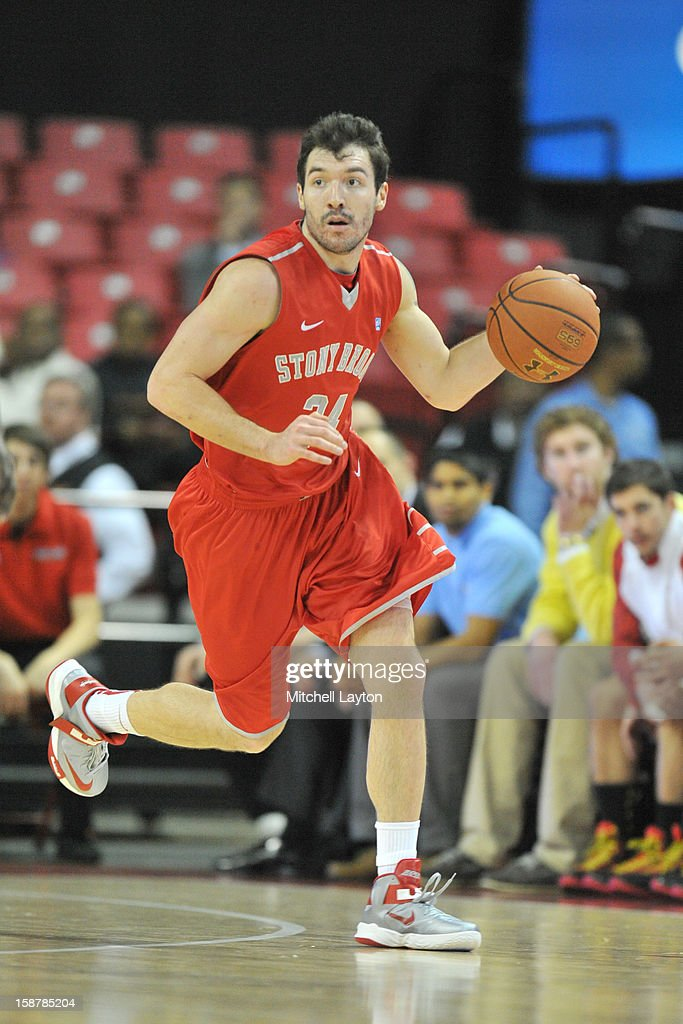 Tommy Brenton #24 of the Stony Brook Seawolves dribbles up court during a college basketball game against the Maryland Terrapins on December 21, 2012 at the Comcast Center in College Park, Maryland. The Terrapins won 76-69.