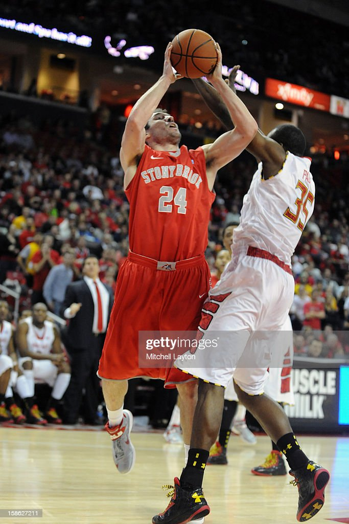 Tommy Brenton #24 of the Stony Brook Seawolves takes a shot over James Padgett #24 of the Maryland Terrapins during a college basketball game on December 21, 2012 at the Comcast Center in College Park, Maryland.