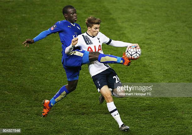 Tommy Carroll of Tottenham Hotspur is challenged by Ngolo Kante of Leicester City during the Emirates FA Cup third round match between Tottenham...
