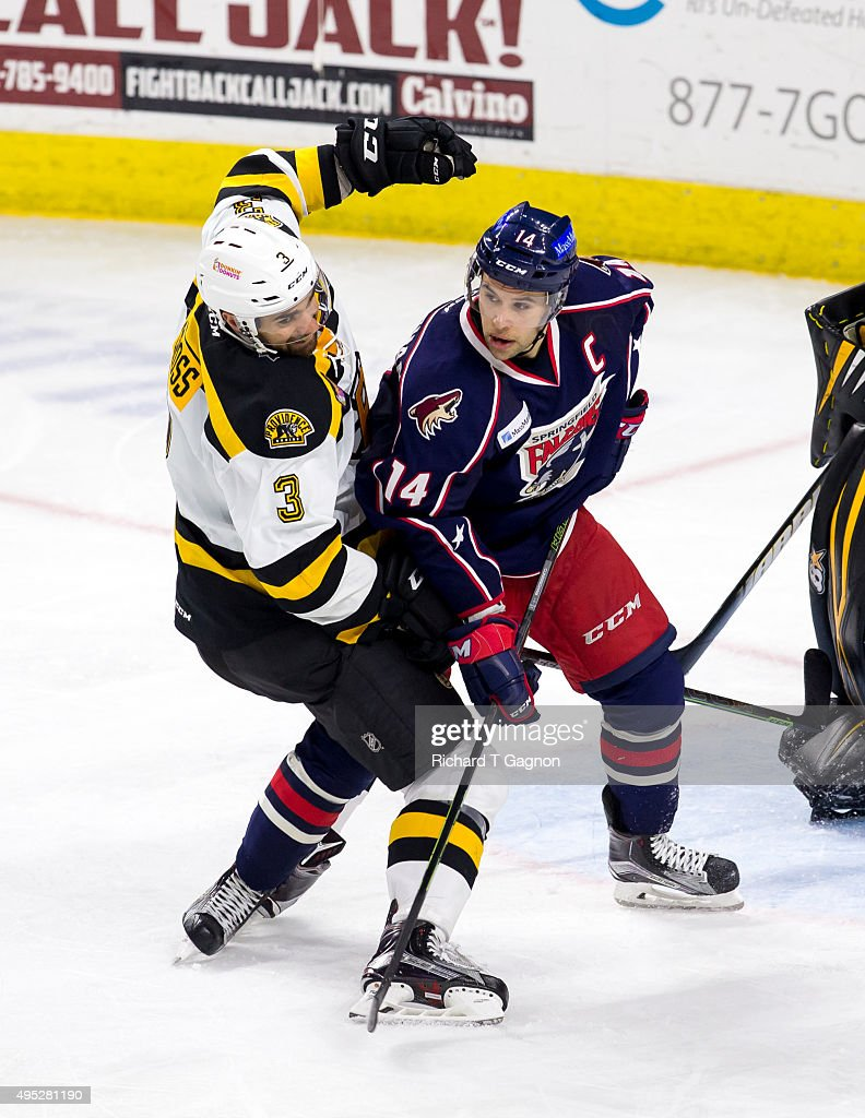 Tommy Cross #3 of the Providence Bruins checks Craig Cunningham #14 of the Springfield Falcons during an American Hockey League game at the Dunkin' Donuts Center on November 1, 2015 in Providence, Rhode Island. The Falcons won 5-2.
