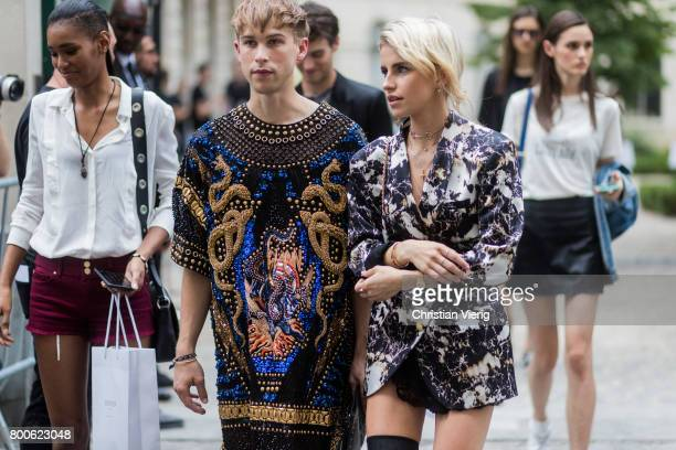 Tommy Dorfman and Caroline Daur outside Balmain during Paris Fashion Week Menswear Spring/Summer 2018 Day Four on June 24 2017 in Paris France