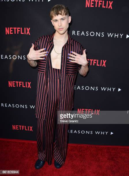 Tommy Dorfman arrives at the Premiere Of Netflix's '13 Reasons Why' at Paramount Pictures on March 30 2017 in Los Angeles California
