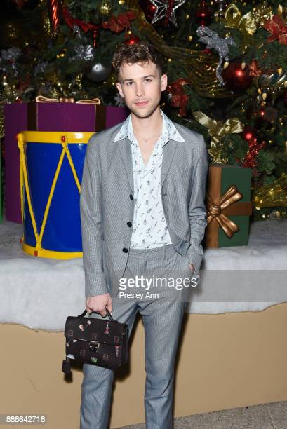Tommy Dorfman attends Hollywood Foreign Press Association hosts Annual Holiday Party and Golden Globes 75th Anniversary Special Screening at...