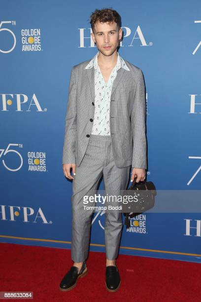 Tommy Dorfman attends the Hollywood Foreign Press Association Hosts Annual Holiday Party And Golden Globes 75th Anniversary Special Screening at...