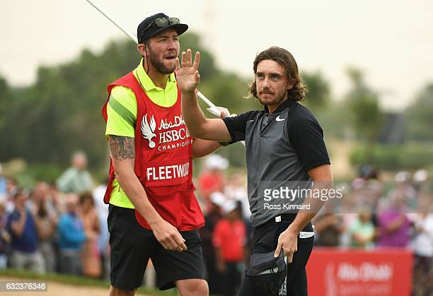 Tommy Fleetwood of England acknowlegdes after his birdie on the 18th green during the final round of the Abu Dhabi HSBC Championship at Abu Dhabi...