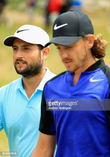 Tommy Fleetwood of England and Alexander Levy of France look on from the 5th during day two of the HNA Open de Feance at Le Golf National on June 30...