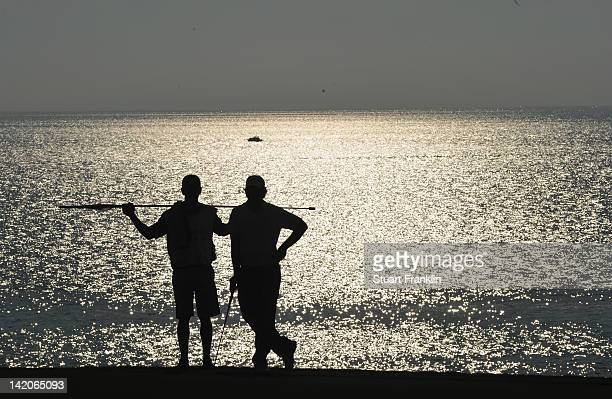 Tommy Fleetwood of England and caddie wait during the first round of the Sicilian Open at Verdura Golf and Spa Resort on March 29 2012 in Sciacca...
