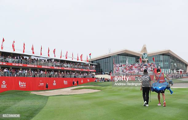 Tommy Fleetwood of England and his caddie walk to the 18th green during the final round of the Abu Dhabi HSBC Championship at Abu Dhabi Golf Club on...